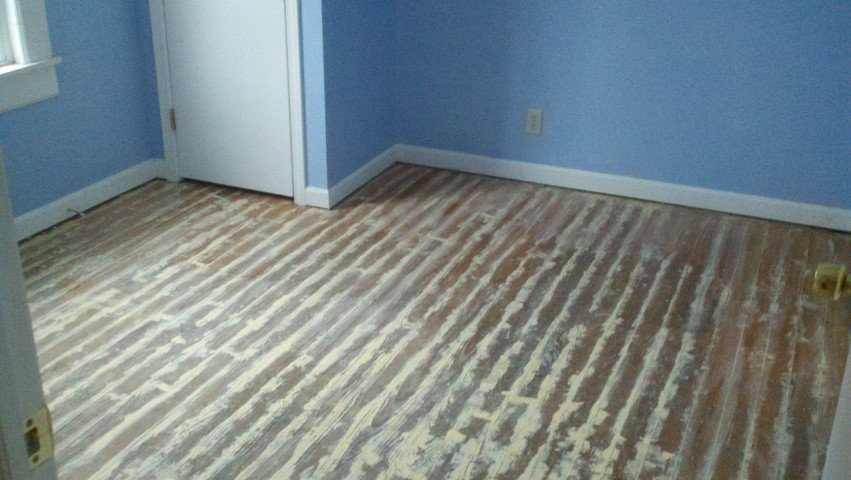 a hardwood floor in need of being refinished