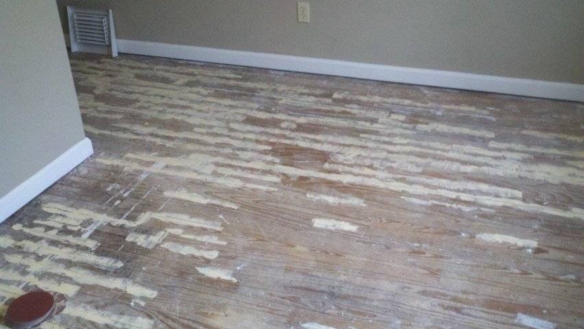 a severely damaged wood floor surface