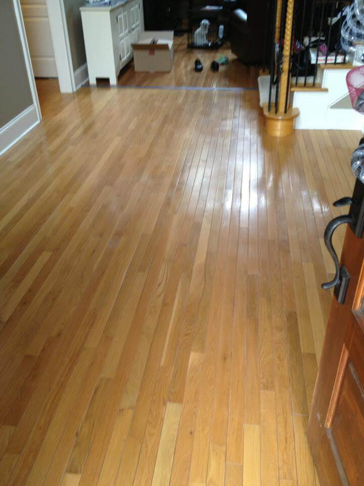 a light brown hardwood floor that needs to be resurfaced