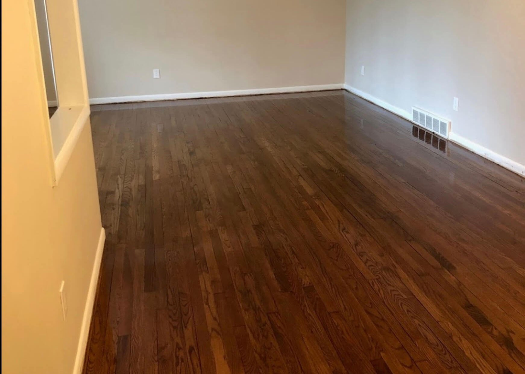 A perfectly refinished and restained hardwood floor