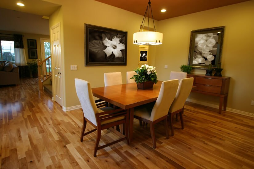 A pontiac dining room with floors refinished by Fabulous Floors.